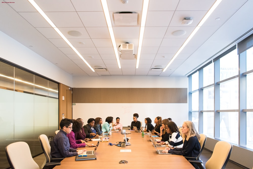 people sitting on conference room