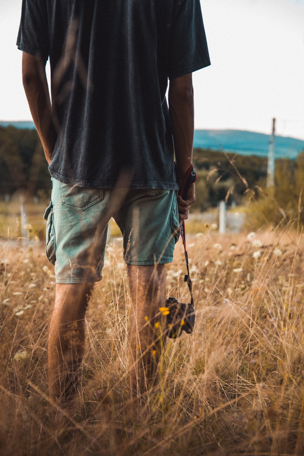 person wearing green shorts close-up photography