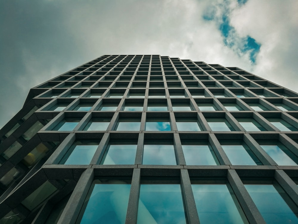 low-angle photography of curtain-wall high-rise building during daytime