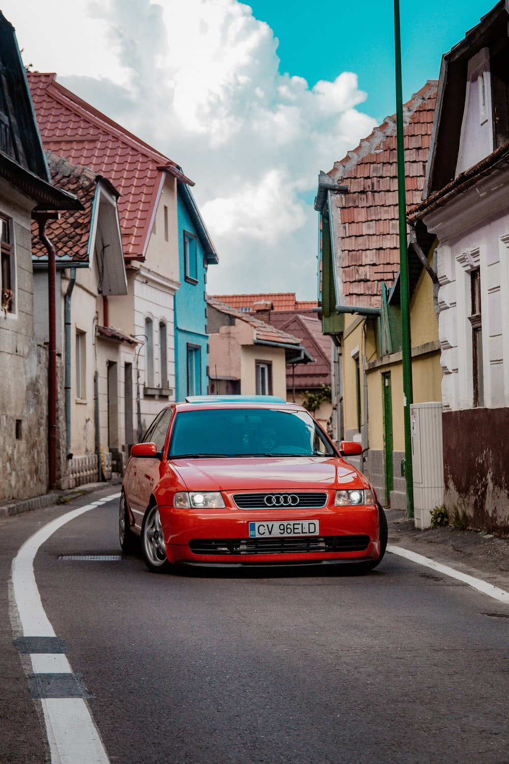 red Audi RS2 on road near houses