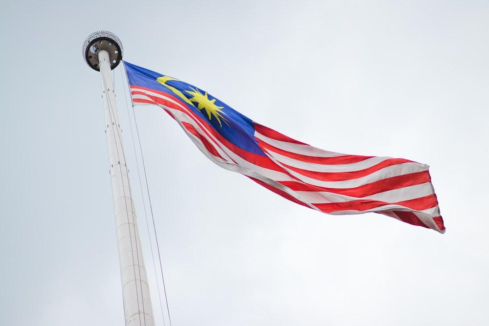 raised Malaysia flag during daytime