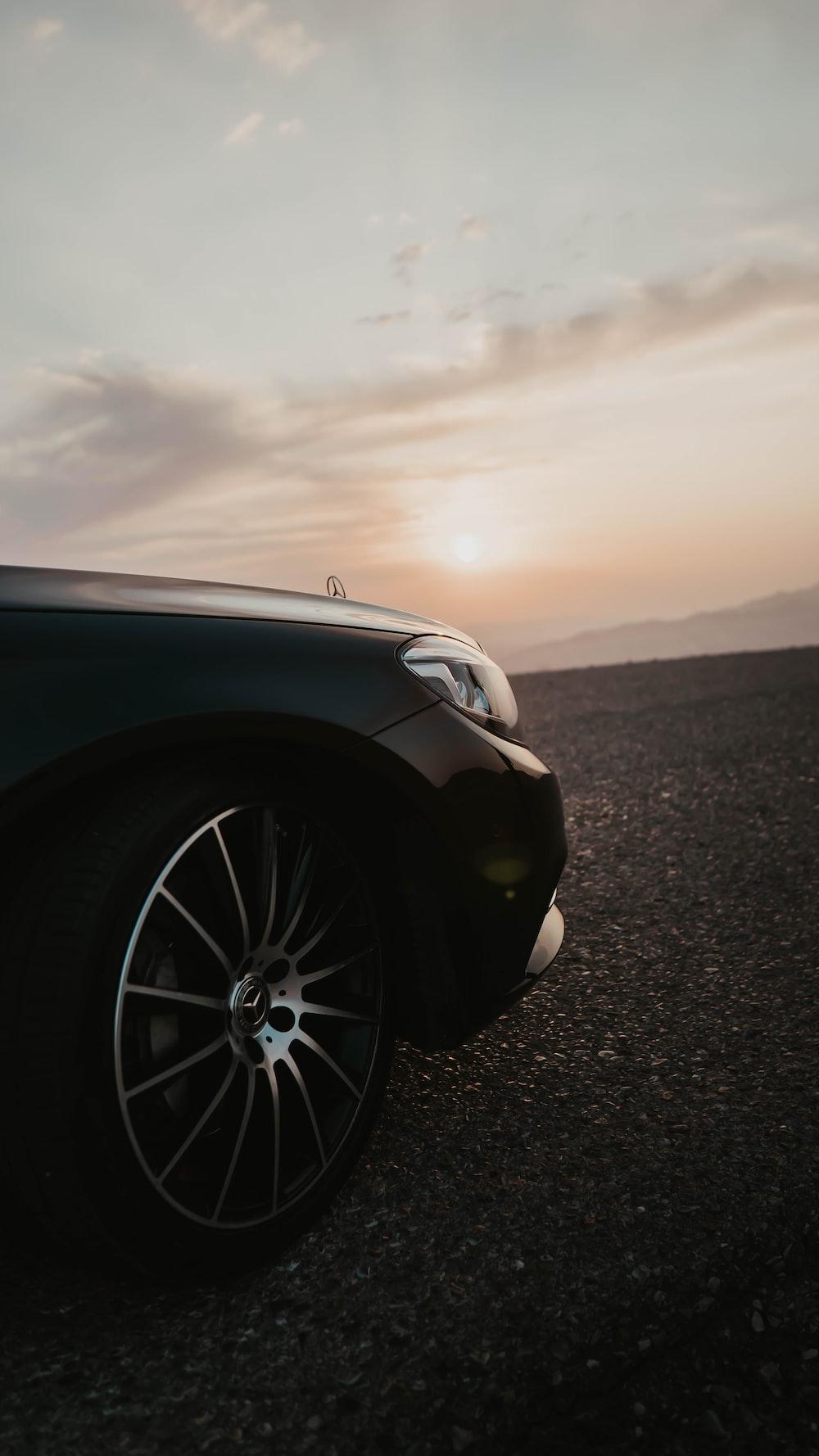 black Mercedes-Benz vehicle on pavement