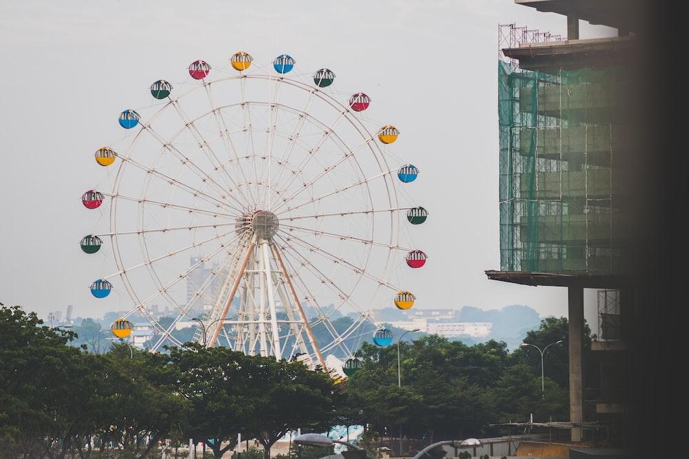 Ferris wheel near trees