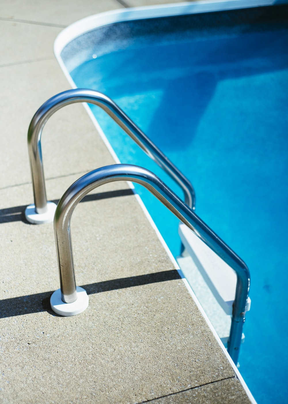 grey and white pool ladder photo – Free Sink faucet Image on Unsplash