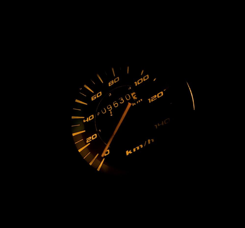 black vehicle speedometer