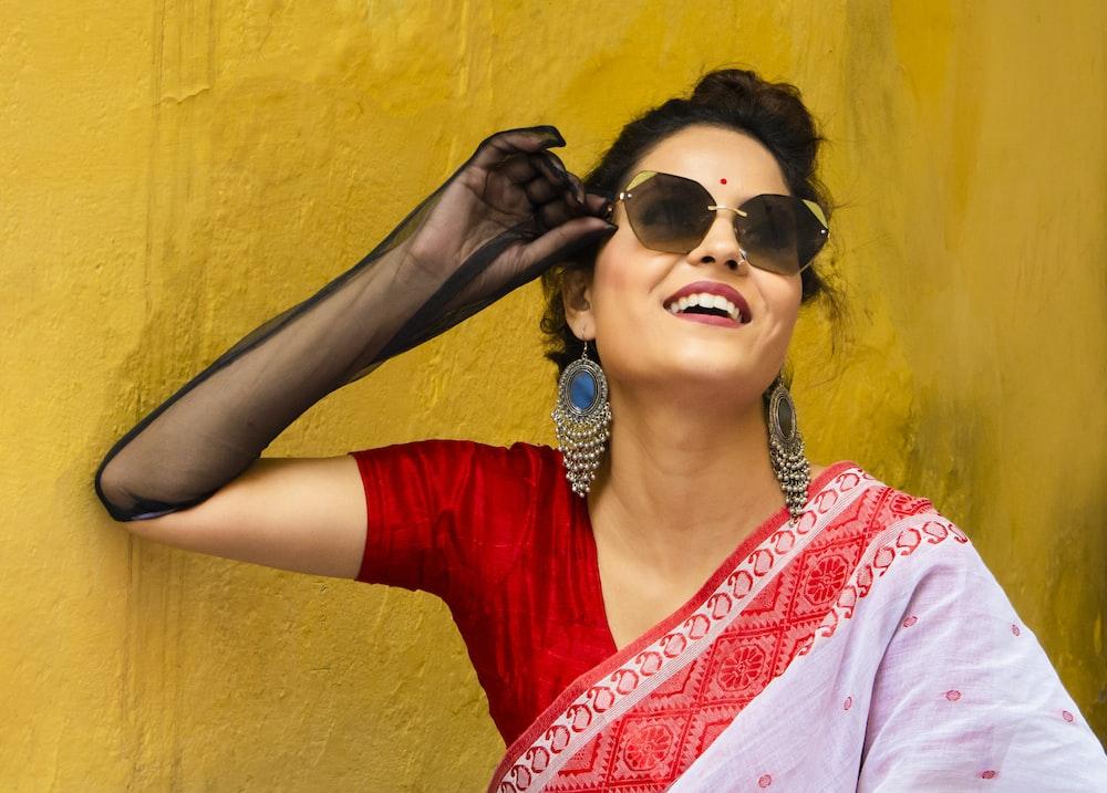 woman leaning beside wall