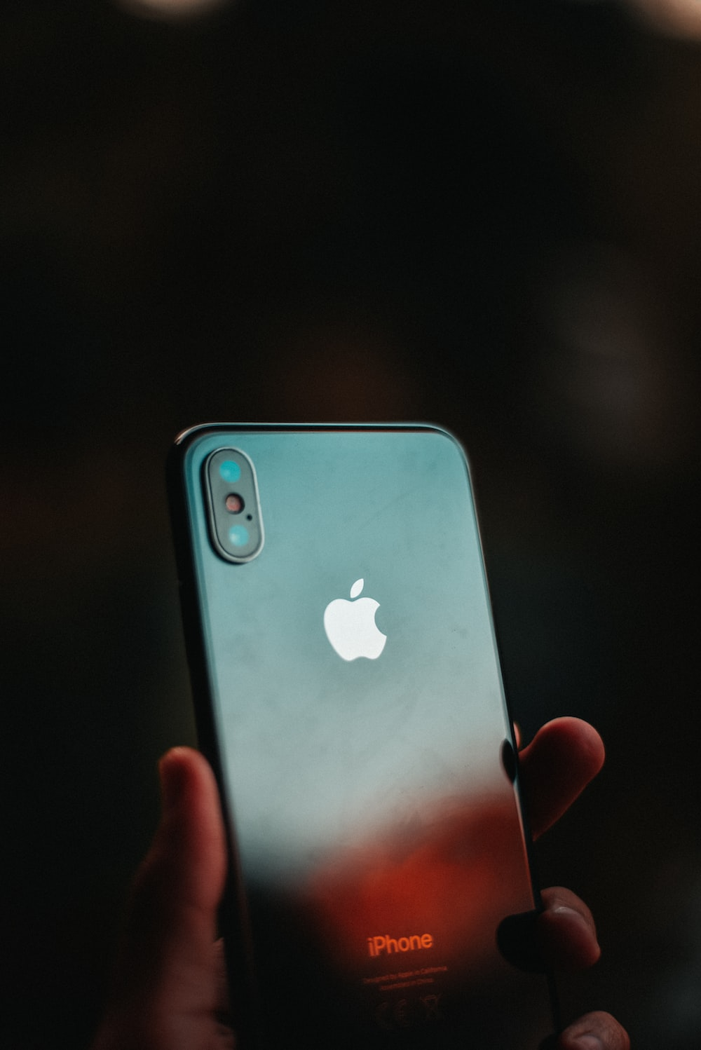 post-2018 iPhone in person's hand