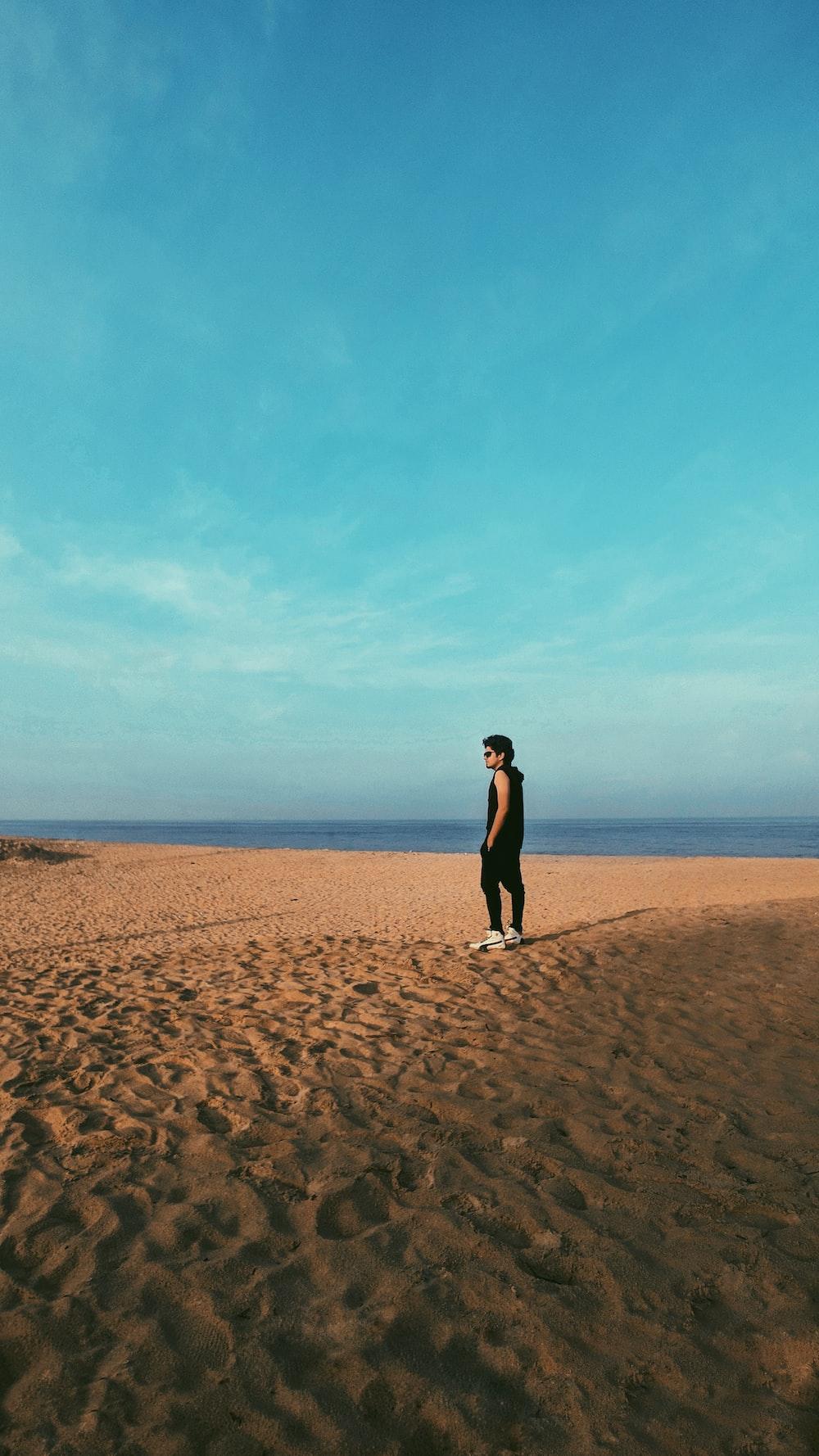 man standing on sand