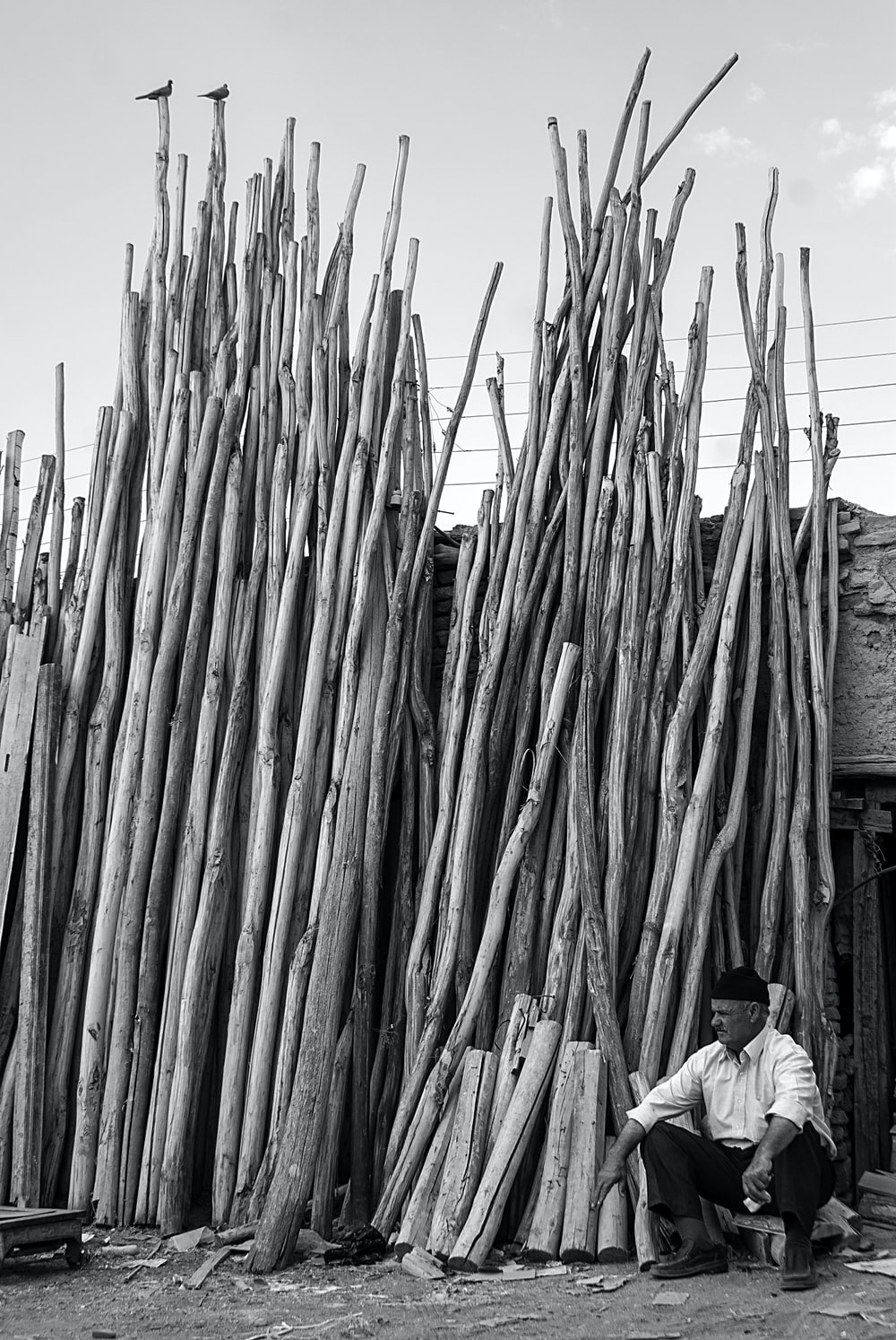 man sitting near the stick