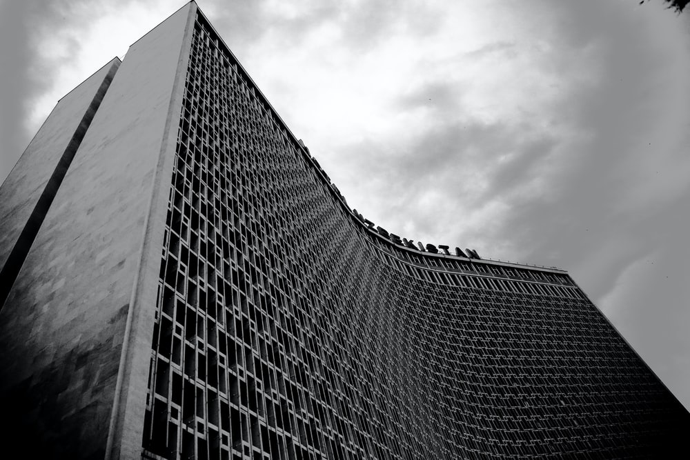 tall building grey-scale photography