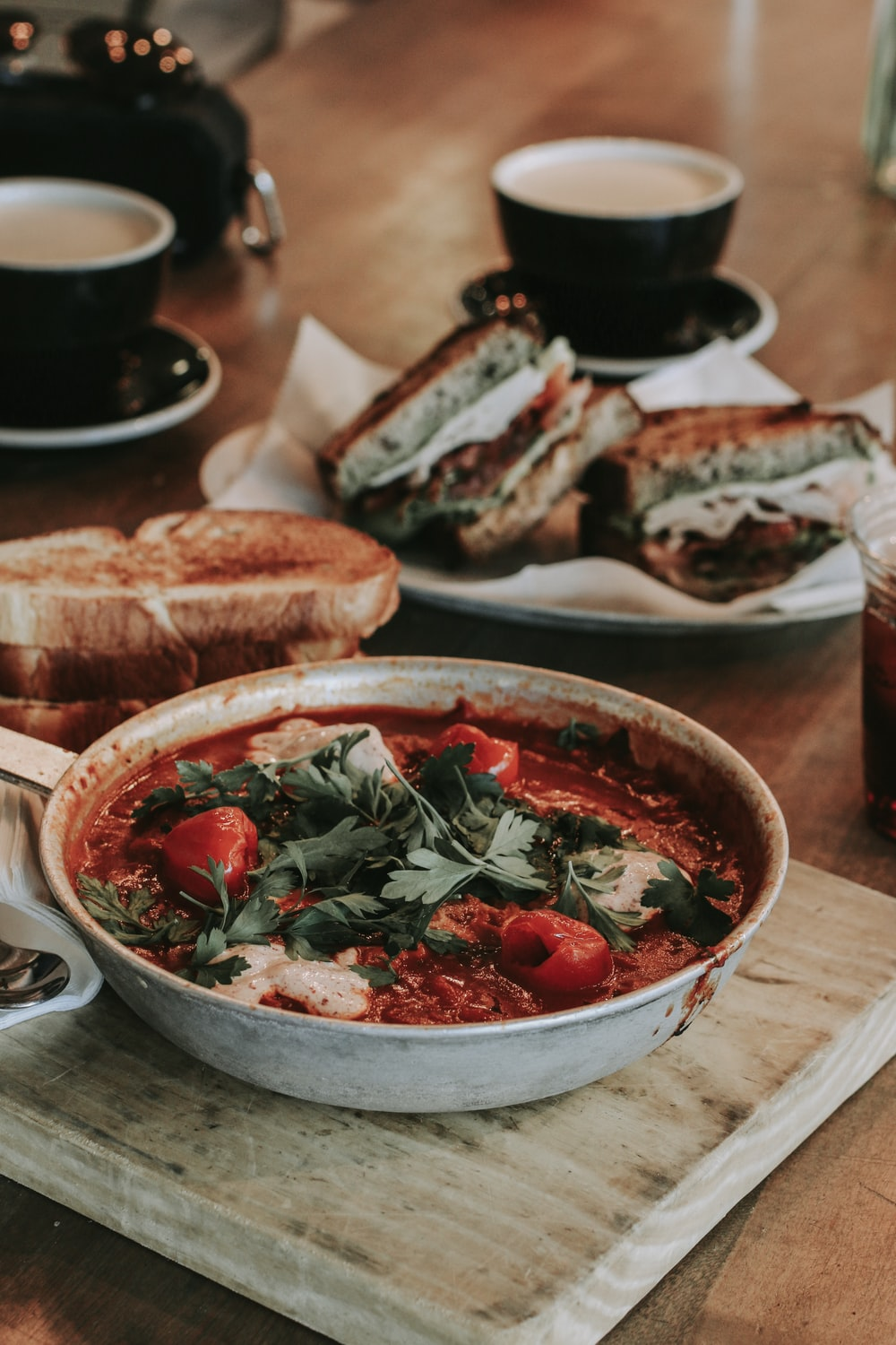 stewed food with parsley and tomatoes in bowl