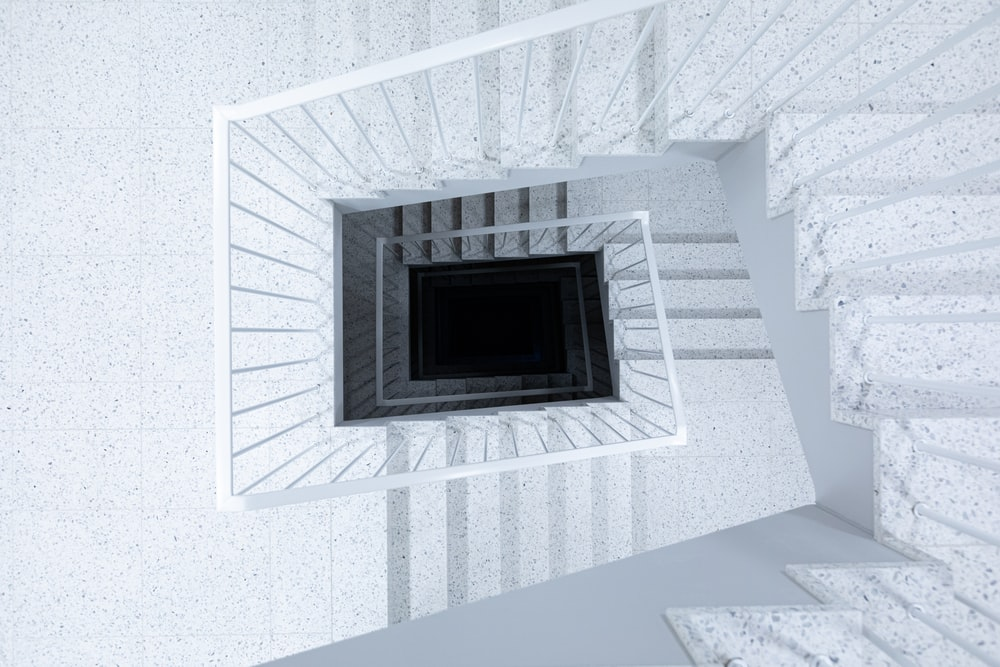 white concrete spiral stairs
