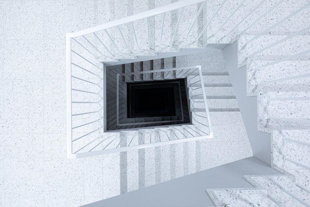 white concrete spiral stairs