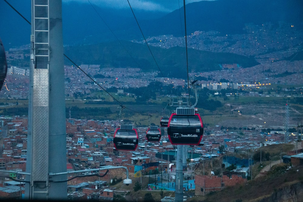 cable cars above houses