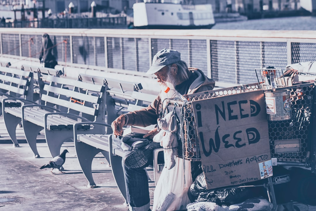a panhandler needing help from others to taste weed