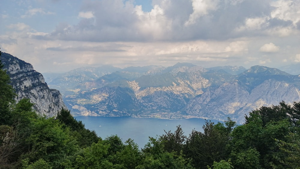 photography of lake and mountain range during daytime