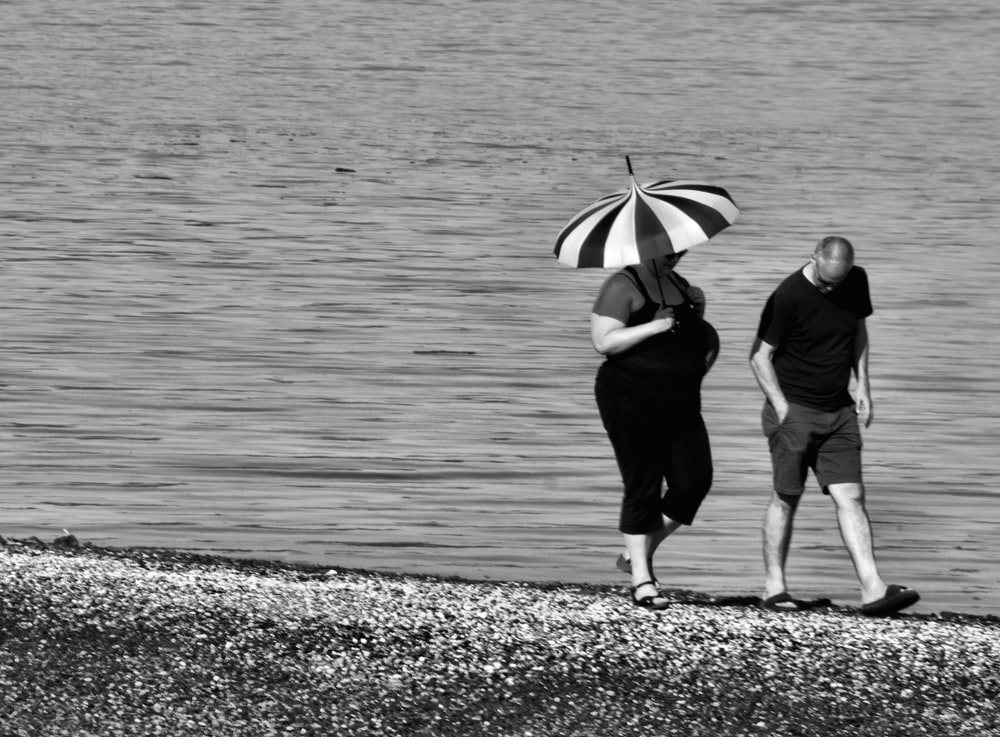 couple walking on seashore