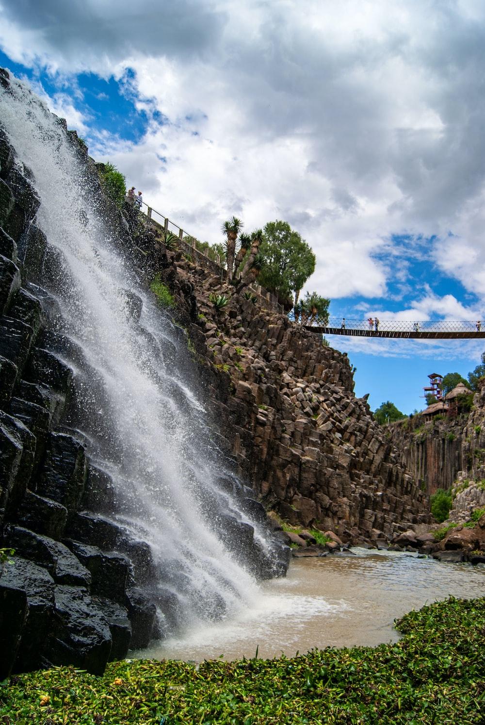 waterfalls near bridge