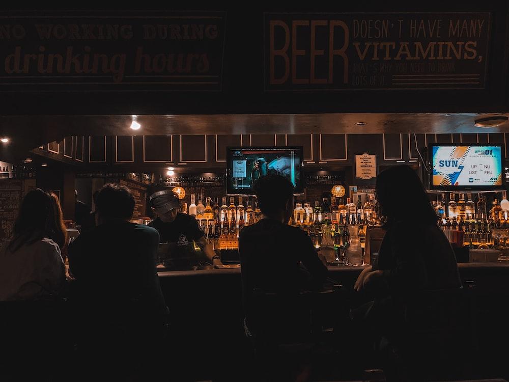people on bar area