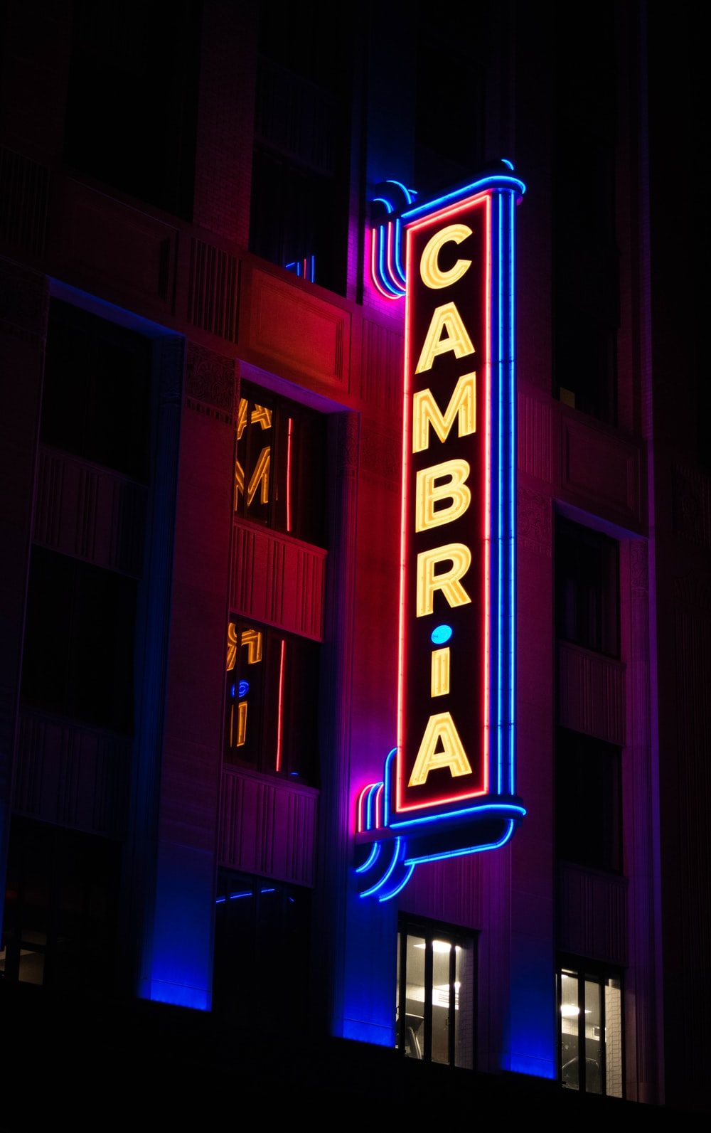 lighted Cambria signage at night