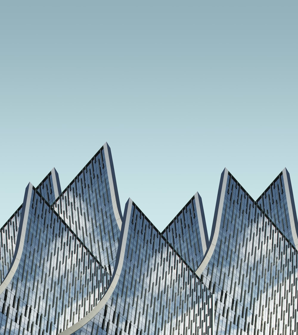 architectural photography of blue and white buildingg