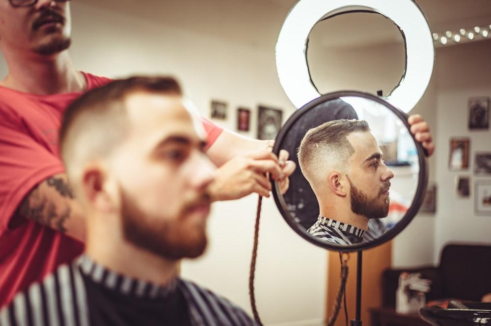 man getting haircut inside room