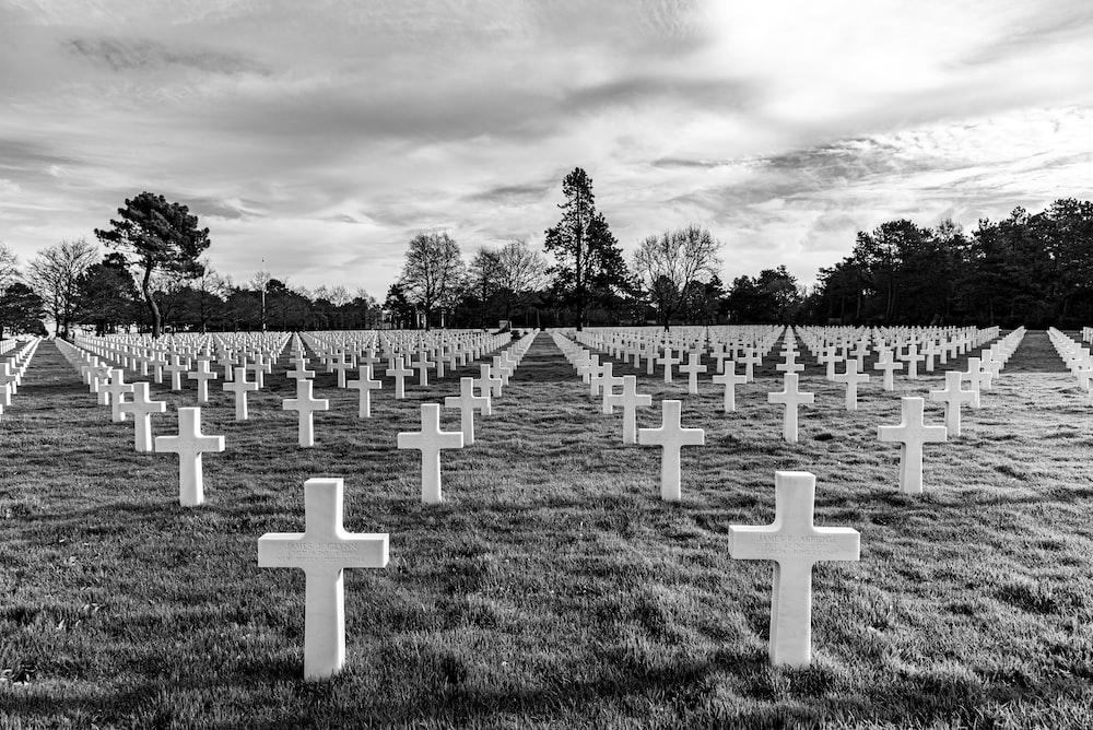 cross on graveyard grayscale photo