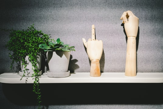 two wooden hand table decors