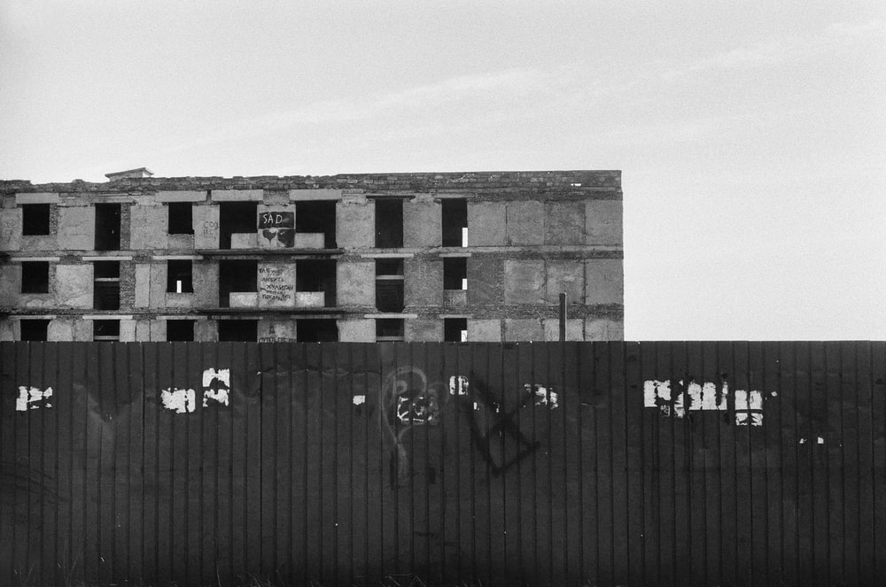 grayscale photography of abandoned building