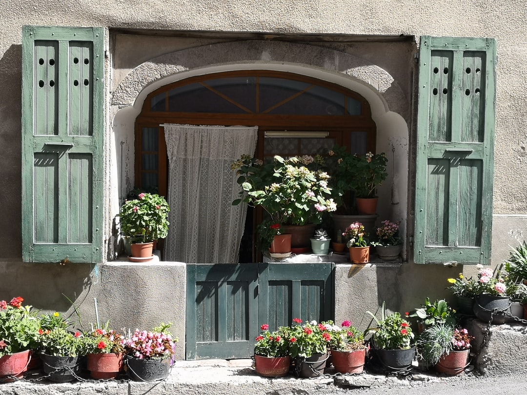 Flowers decorating this old house located in the middle-aged town of Embrun, in the French Alps.