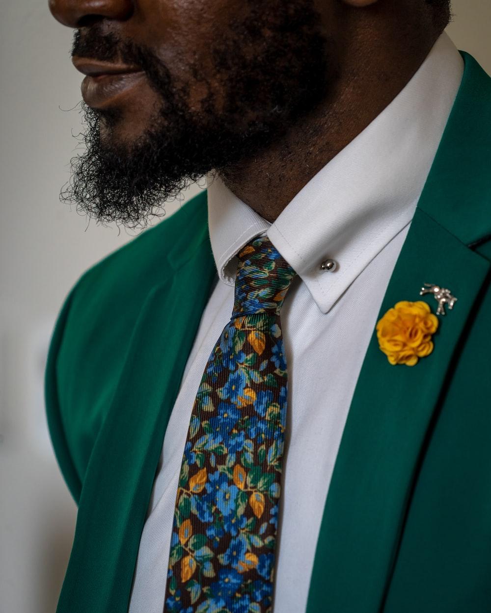 person wearing green dress shirt close-up photography