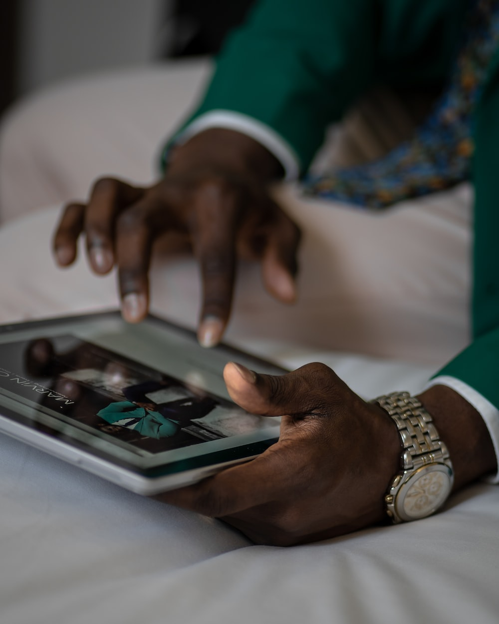 person holding a tablet close-up photography