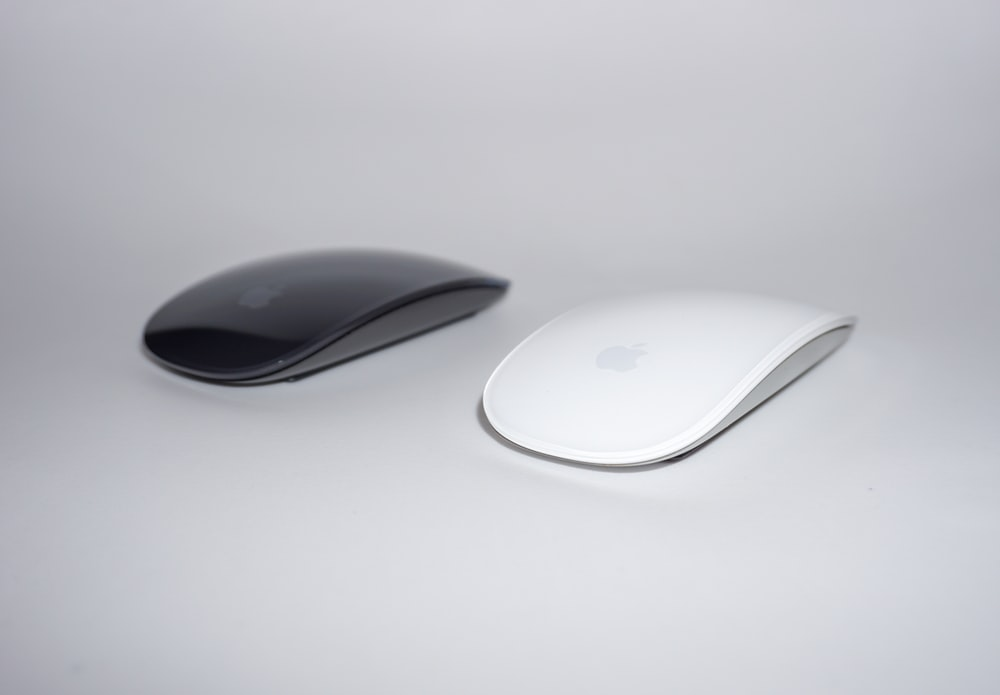 two black and white cordless mouse close-up photography