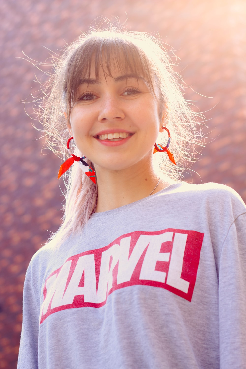 woman wearing gray and red Marvel shirt