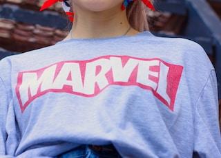woman wearing blue Marvel sweater
