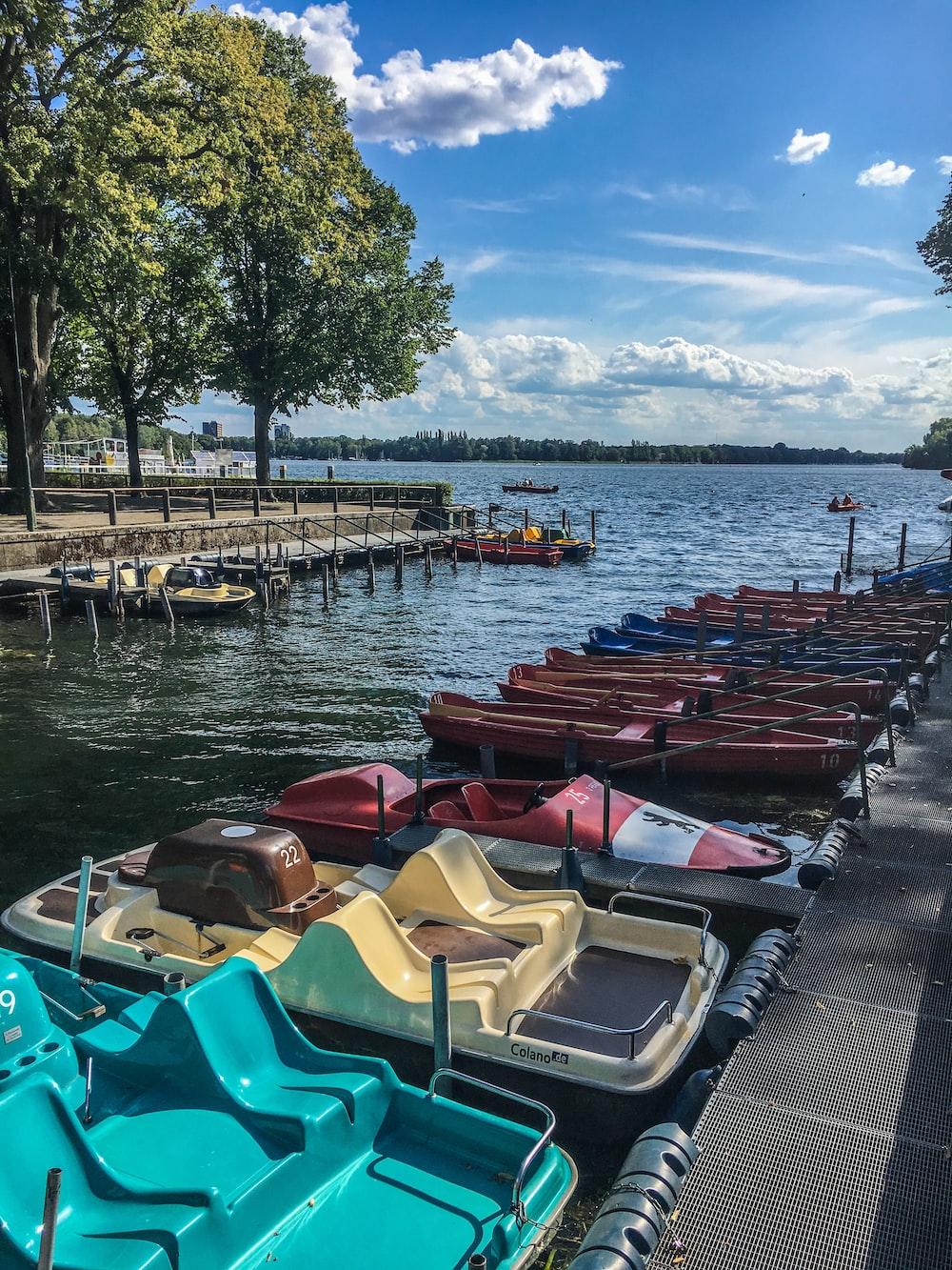 bunch of kayaks near dock
