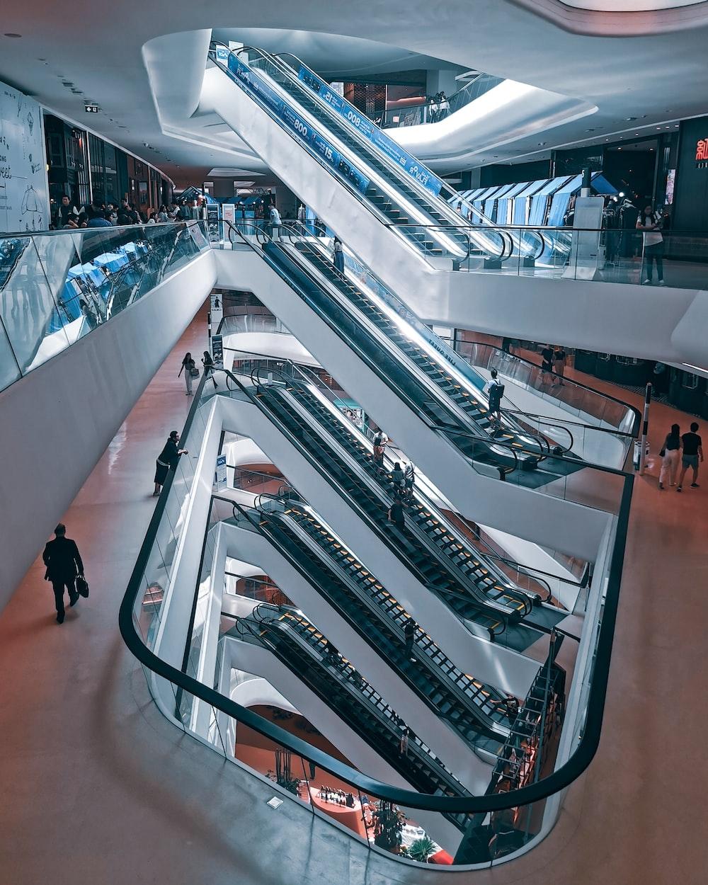 people in mall near escalators