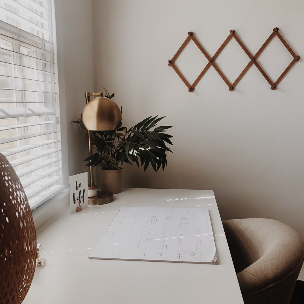 gold table lamp on desk