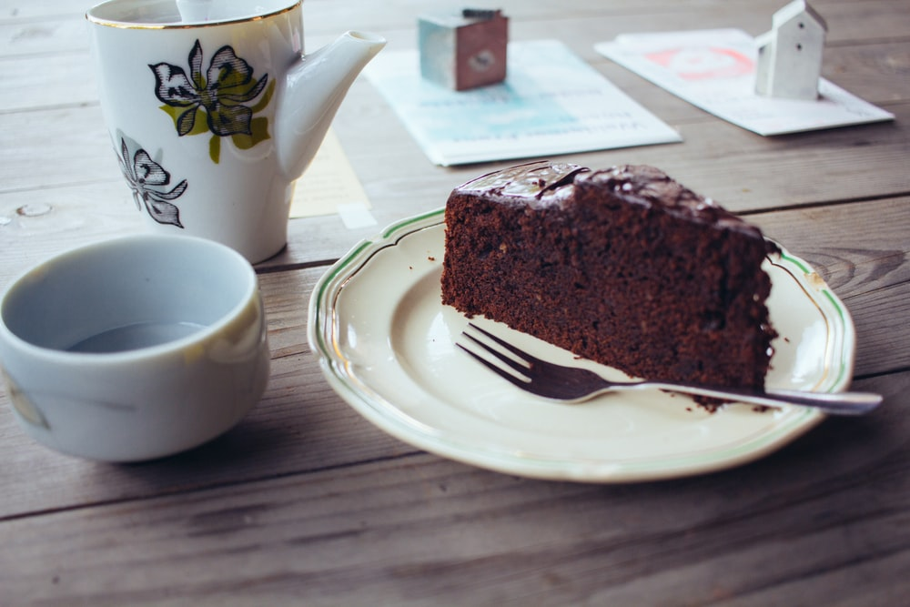 plate of sliced chocolate cake