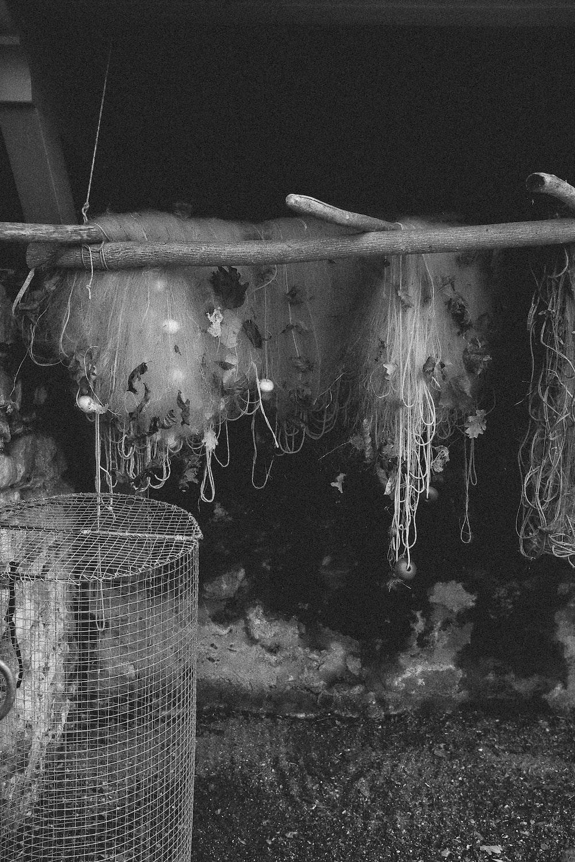fishing nets hung on wooden sticks