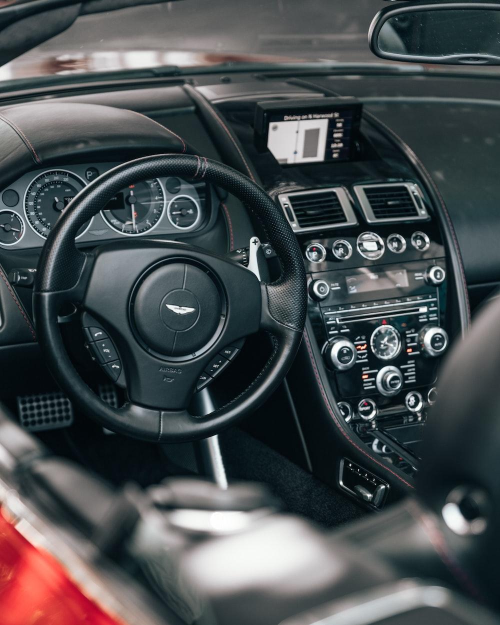black Aston Martin steering wheel