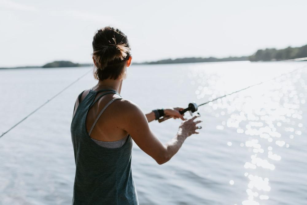 woman holding fishing rod