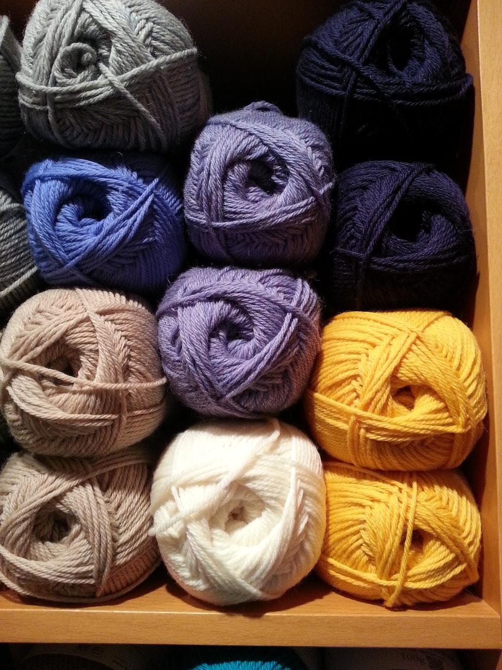 assorted-color yarn rolls piled in shelf