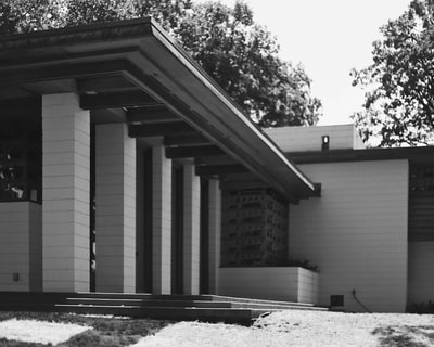 greyscale photography of building midcentury modern teams background