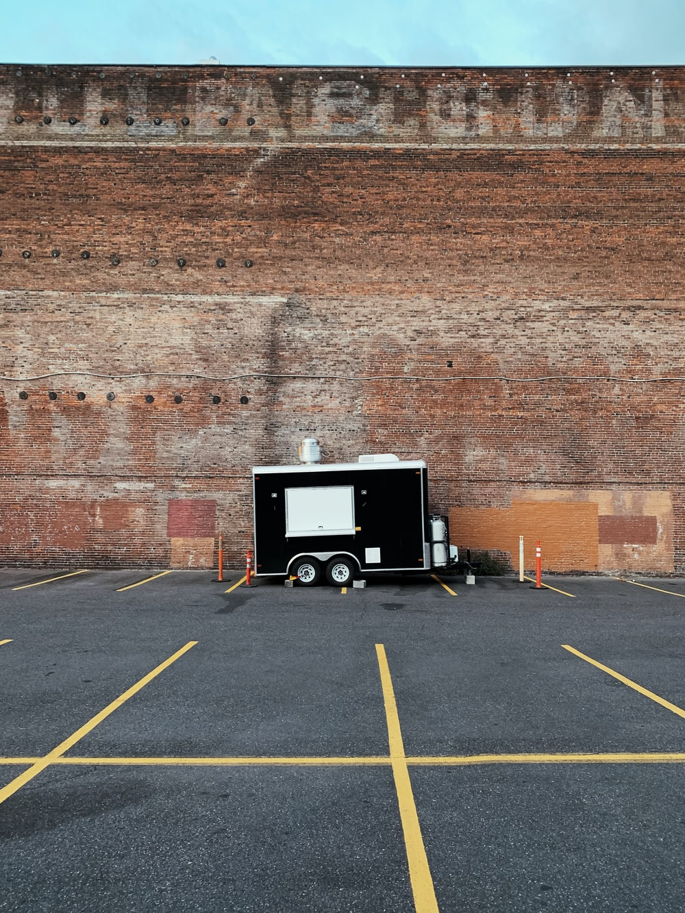 black and white enclosed trailer near wall