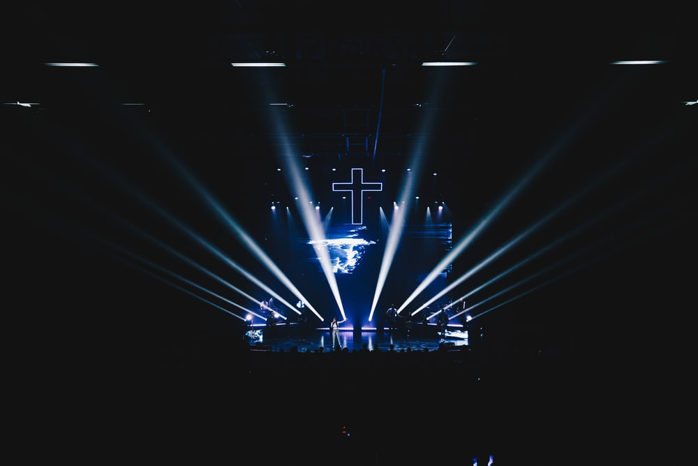 blue stage lights with cross art