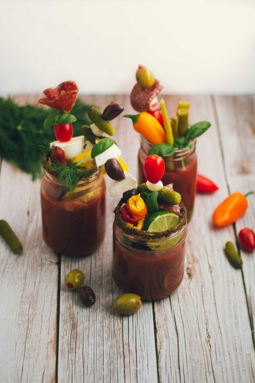 three jars of vegetables and liquid