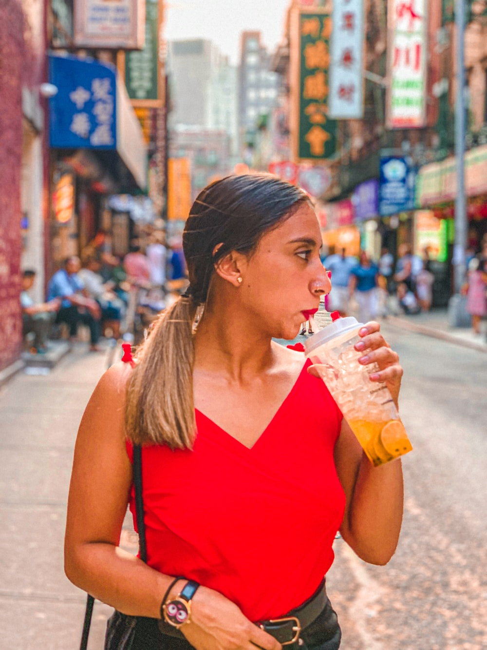 woman sipping drinking cup