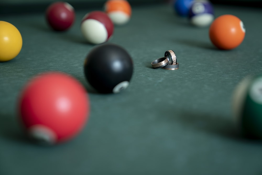 gold rings surrounded with billiard balls