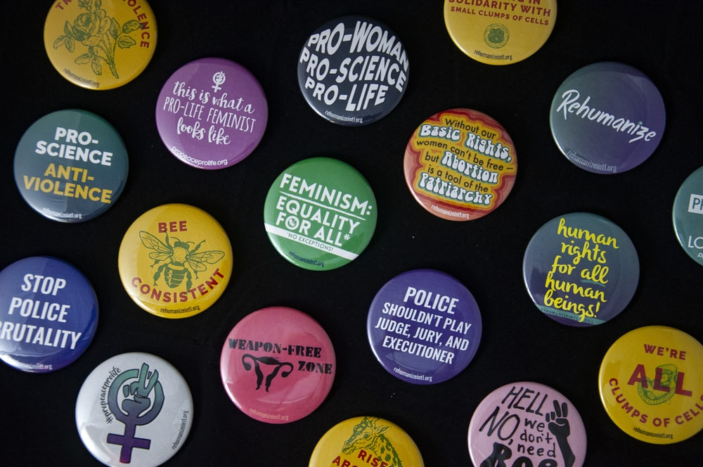 assorted-color pin back badges